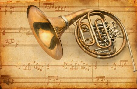 french horn. grunge musical background  photo