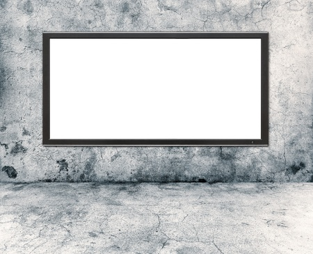 gray concrete wall and plasma tv