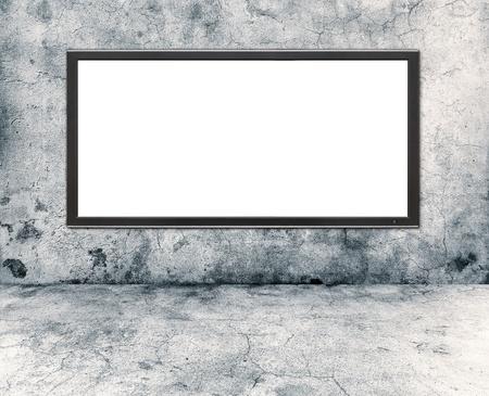 gray concrete wall and plasma tv