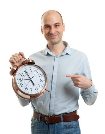 hombre calvo: Hombre con un reloj de alarma Foto de archivo