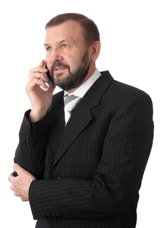 cheerful senior business man talking on a cell phone. Isolated on white photo
