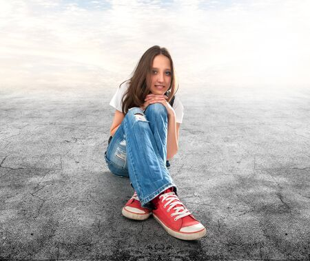 young girl sitting on a floor photo