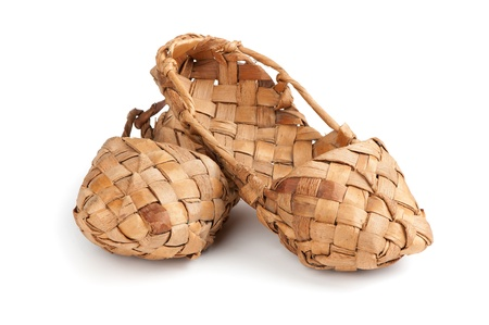 structured: bast shoes. Old Russian sandals isolated over white