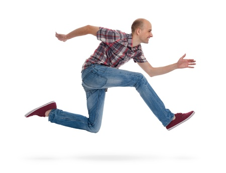man in jeans: Young man running Stock Photo