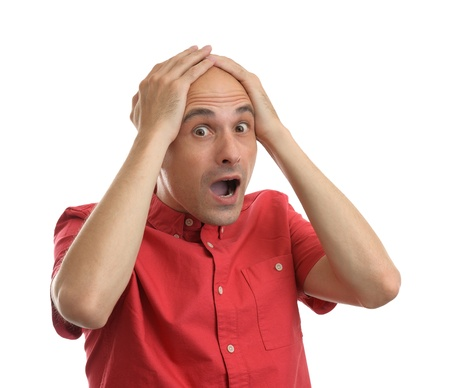 Shocking man holding his head over white background Stock Photo - 20680596