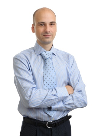 Portrait of young business man with folded hands over white background Imagens
