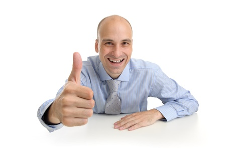 young business man showing thumb up gesture photo