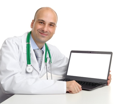 doctor and laptop computer with blank screen, isolated on a white background photo