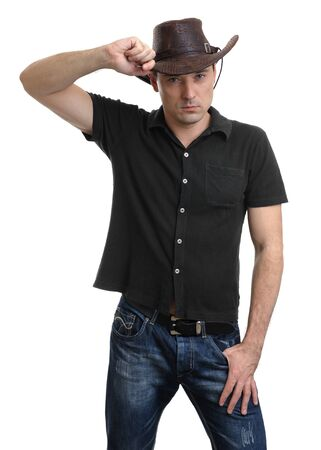 handsome man in a cowboy hat isolated on white photo