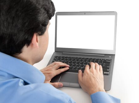 businessman working on his laptop with blank screen photo