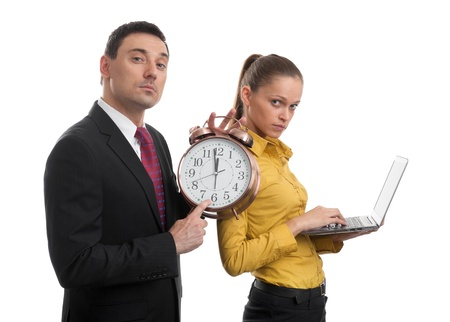 business people with laptop and alarm clock photo