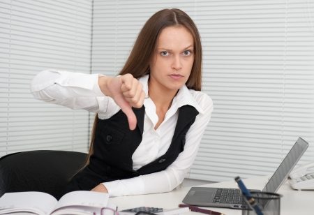 young business woman showing dislike sign photo