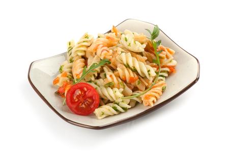 fusilli: Fusilli pasta with tomato sauce, basil and arugula Stock Photo