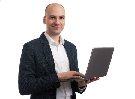 attractive young business man with laptop on white backhground photo