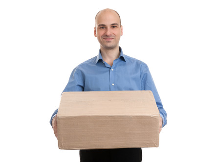 consign: handsome young delivery man portrait isolated on white