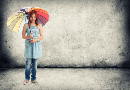 young girl with an umbrella photo