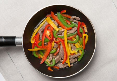 meat and vegetables in a pan photo