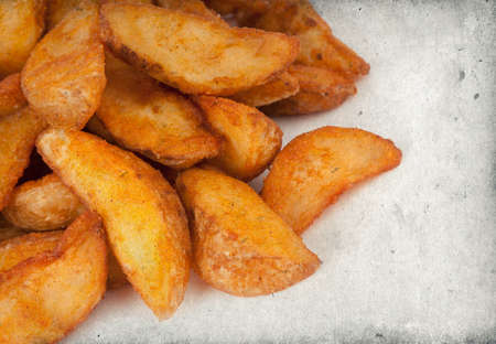 Fried potato wedges close up photo