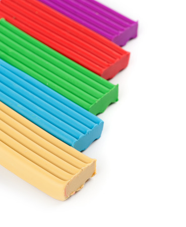 pieces of colored plasticine on a white background photo