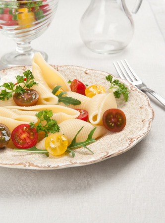 cherry tomatoes: shell pasta with cherry tomatoes