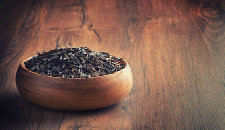 wild rice: wild rice in a wooden bowl