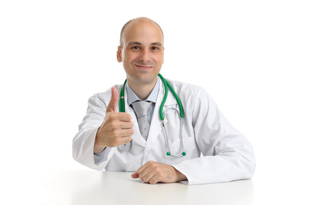 yeah: Happy male doctor with thumbs up isolated on white background Stock Photo