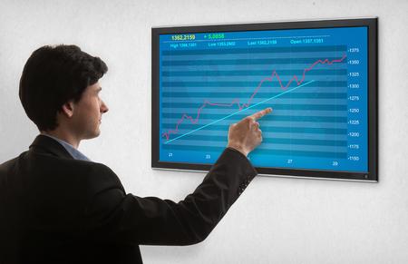 Businessman checking stock market on screen photo
