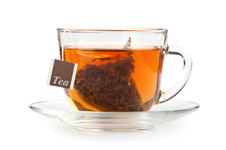 A cup of tea with tea bag, on white background photo
