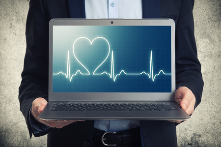 laptop with ekg on the screen  photo