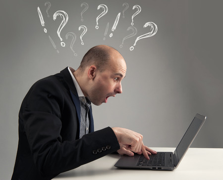 surprised businessman looking at his laptop photo