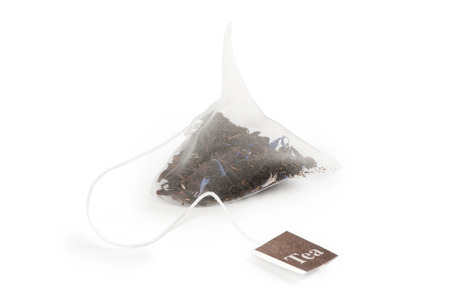 Tea bag on a white  photo
