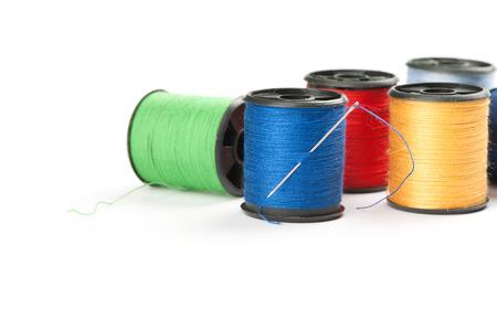 bobbin: bobbin threads with needle isolated on white