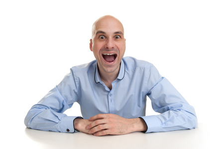 Funny man with crazy surprised look photo