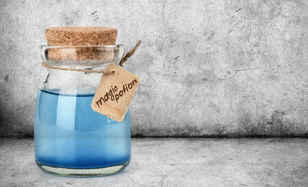 blue magic potion in a bottle photo