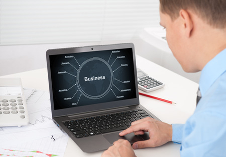 businessman with laptop. business strategy concept photo