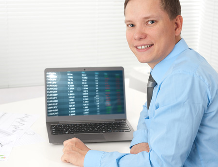 businessman working with his laptop at desk photo