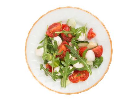 salad from arugula tomatoes and mozzarella. Isolated on white Stock Photo