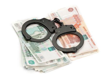 Handcuffs on Russian money photo