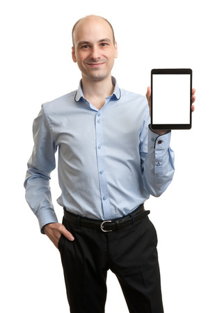 Smiling executive holding a tablet with copy space photo