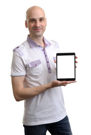 Casual Young Man Holding a Digital Tablet on Isolated White  photo