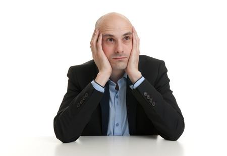 bald man: Retrato de un hombre de negocios pensativo. Aislados en blanco