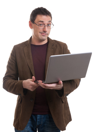 smirking: portrait of happy man with laptop smirking. Isolated on white Stock Photo