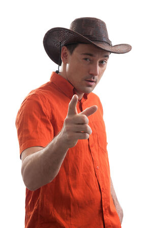 impassive: Stylish young man in a cowboy hat. Isolated on white