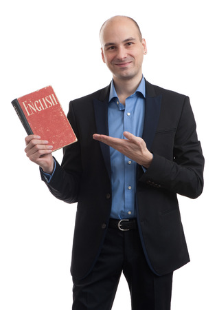 learning english: Learning english concept. Man with book isolated over white Stock Photo