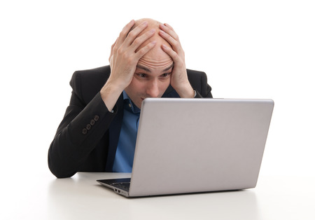 tired businessman: problems with business. tired businessman with laptop