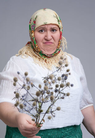 disgusting: portrait of disgusting Russian woman with thistle