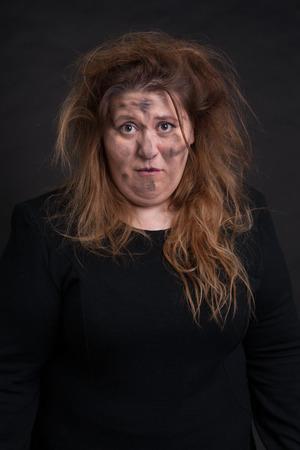 mendicant: close up portrait of grimy woman over black background Stock Photo