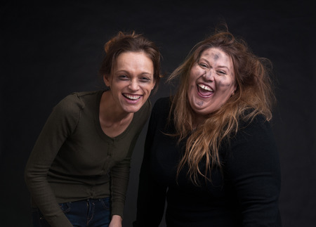 smutty: portrait of drunk two women over black background Stock Photo