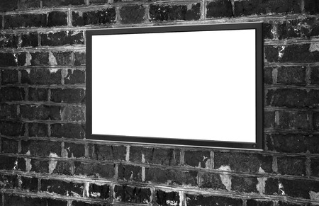 monitor with blank screen for copy space. Brick wall photo