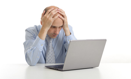 manager office: worried businessman looking at his laptop computer